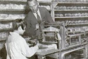 Otto Frederick Rohwedder posing with the first sliced bread machine